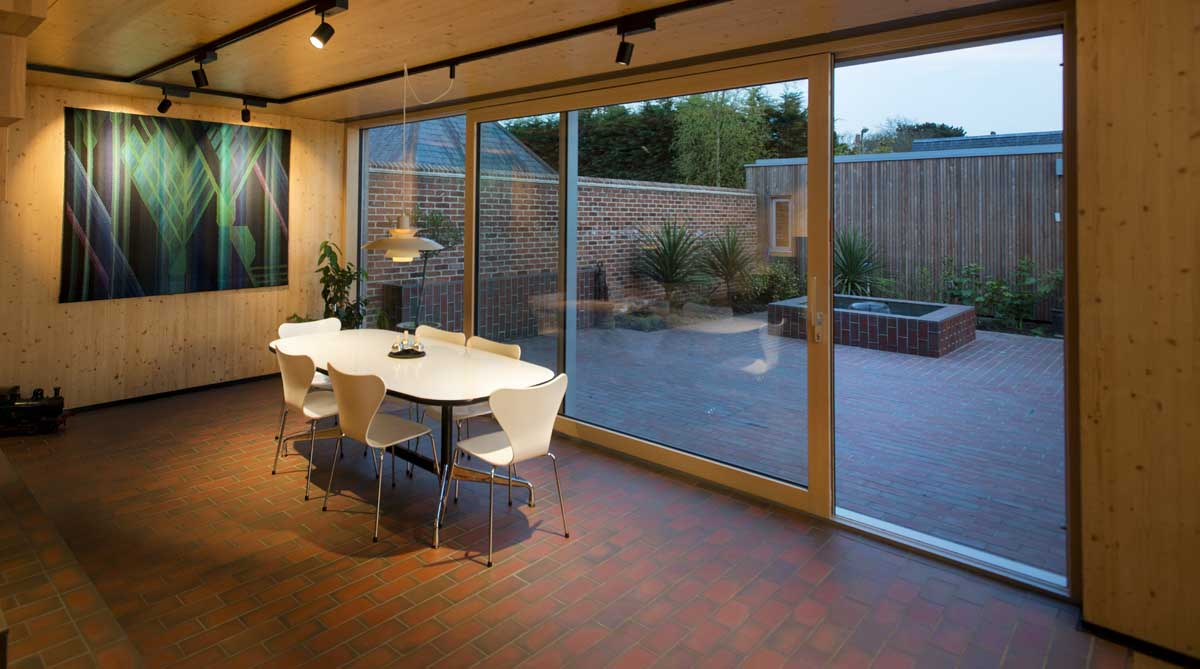 A blend of light and dark multi quarry tiles unite the indoor and outdoor spaces