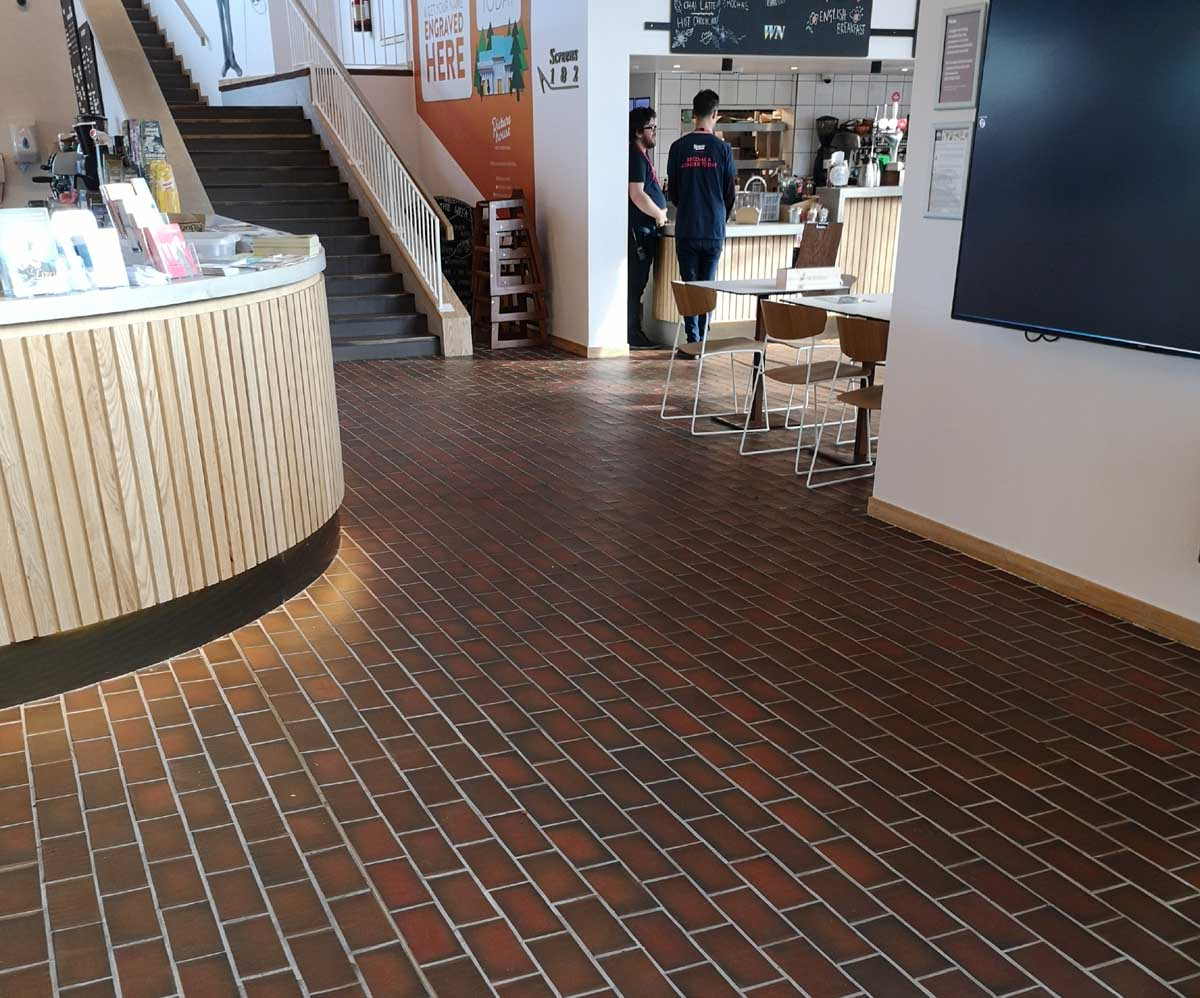 Dark multi quarry tiles were used to renovate West Norwood cinema and library