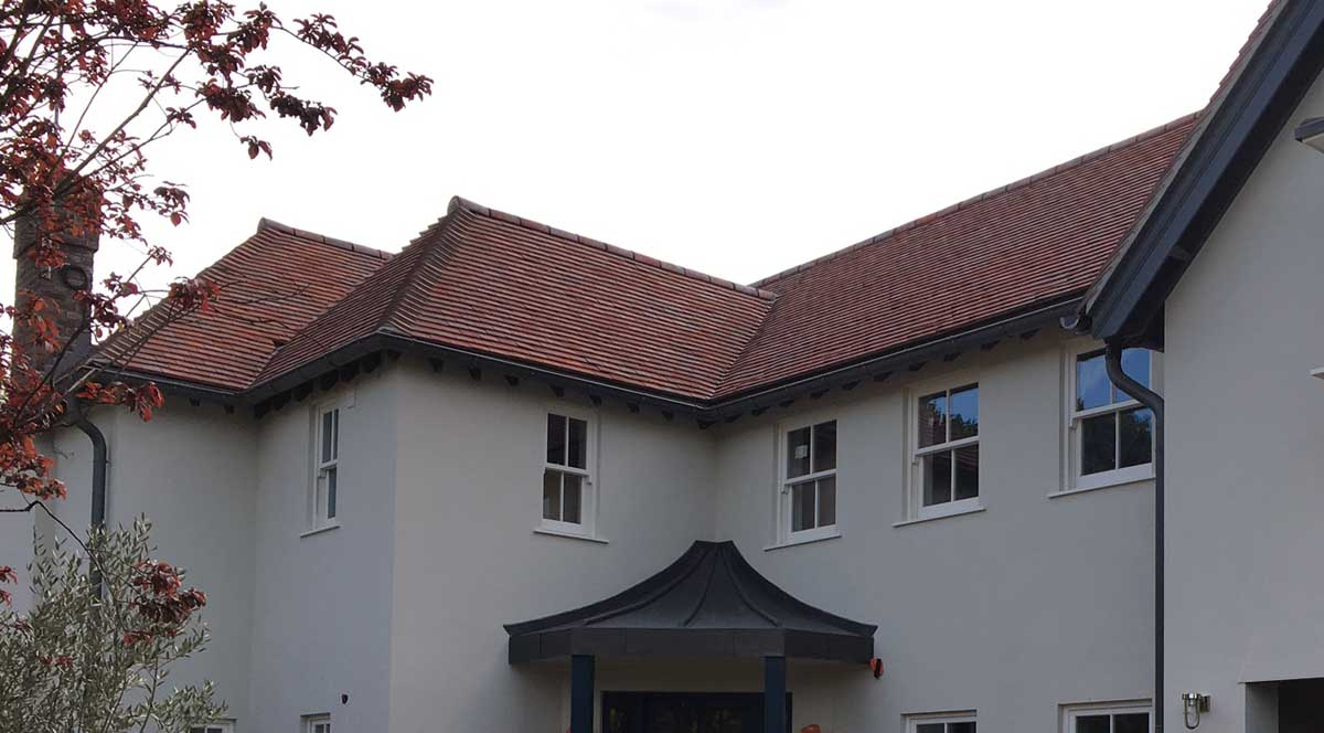 Dreadnought purple brown handmade roof tiles on a selfbuild project in Surrey