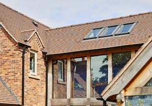 Oakframe selfbuild Collingwood tiles with Furness Bricks Ember blend 300wide