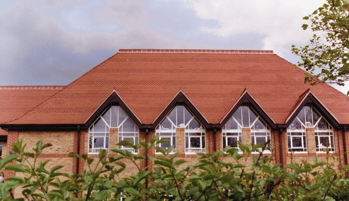 Roding Valley School Red sandfaced with Club and fishtail tiles and 2 hole crested ridges