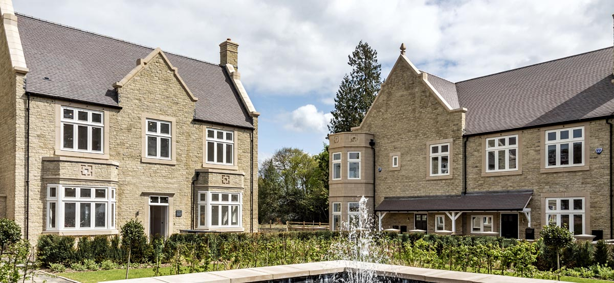Spitfire Homes Hazeley Manor luxury development with dark heather roof tiles