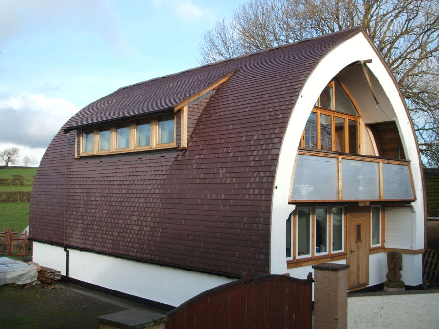 A curved roofing gallery of dreadnought tiles projects for Straw bale home designs