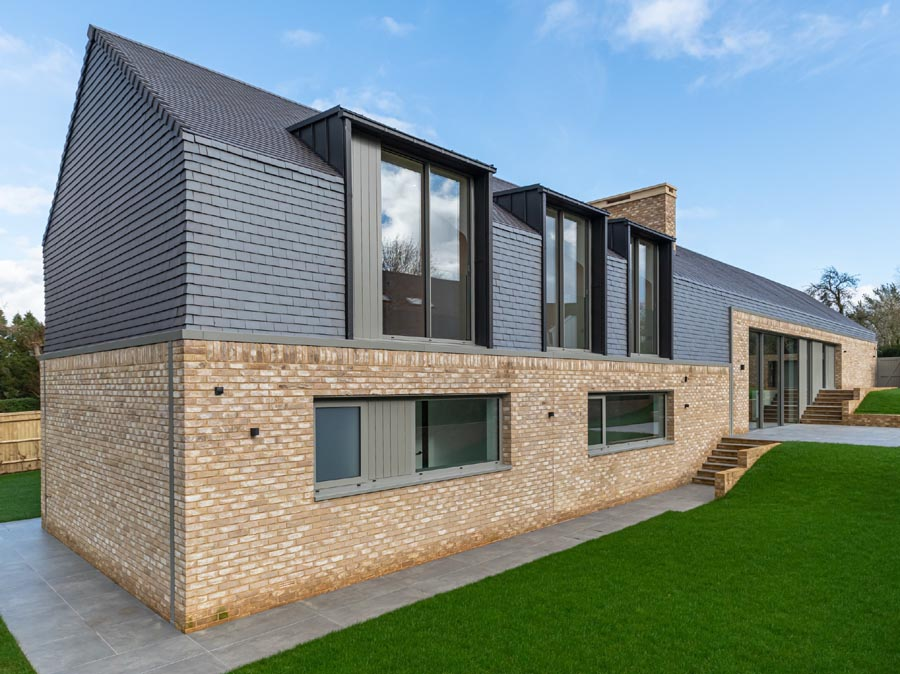 Staffs blue smooth tiles on contemporary newbuild by Sabatini Homes