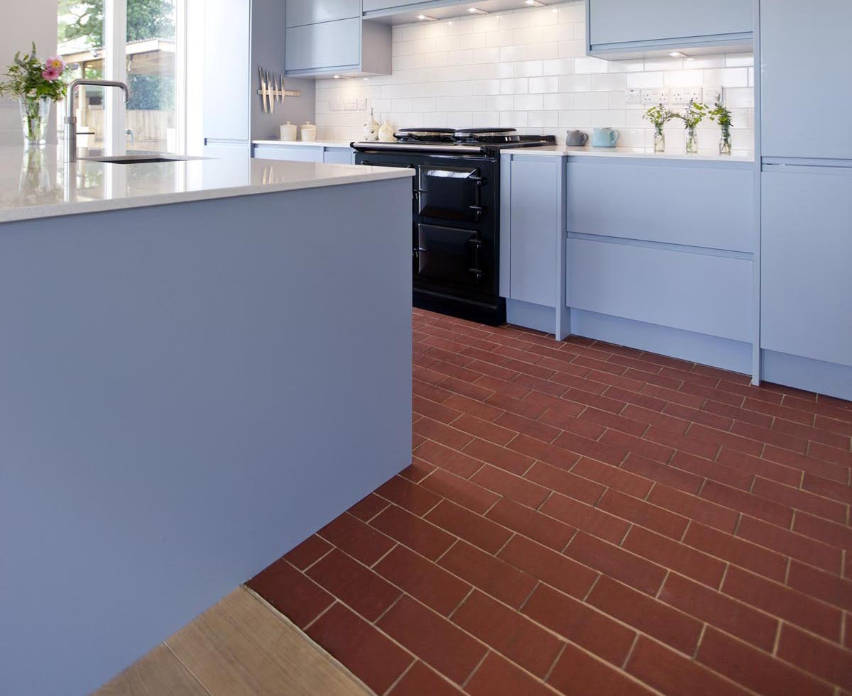 Staffs red rectangular quarry tiles laid over underfloor heating in a contemporary kitchen 1