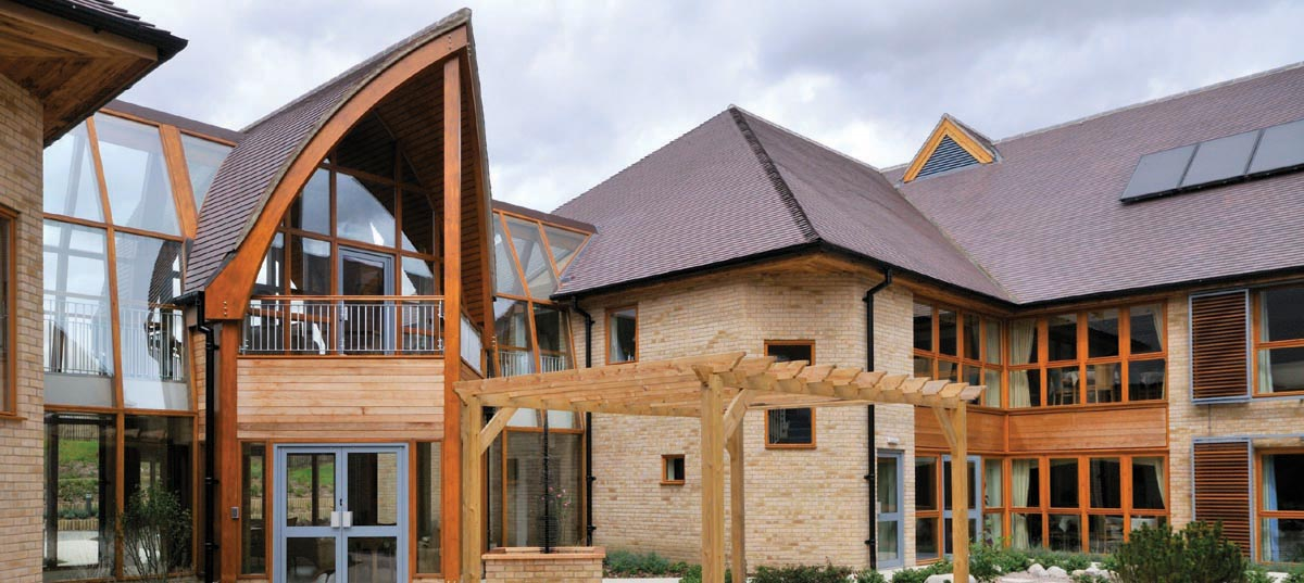 This contemporary award winning carehome uses traditional plain blue brindle roof tiles