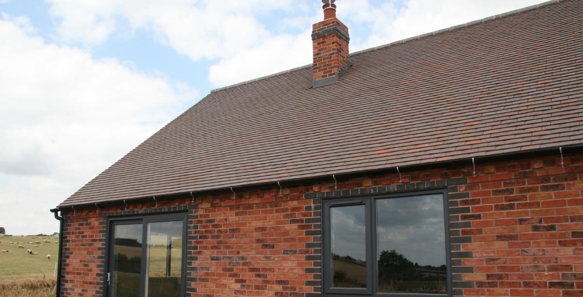 brown brindle tiles on a rural selfbuild in Shropshire