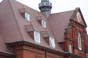 Reroof of Mckee Army Barracks in Dublin with country brown tiles