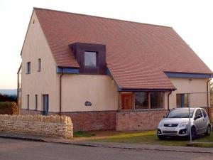 brown antique tiles were chosen for the Cropthorne zero carbon house