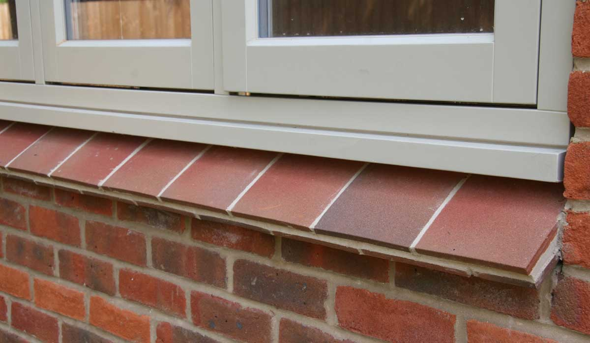 country brown tiles used as creasing tiles under the window