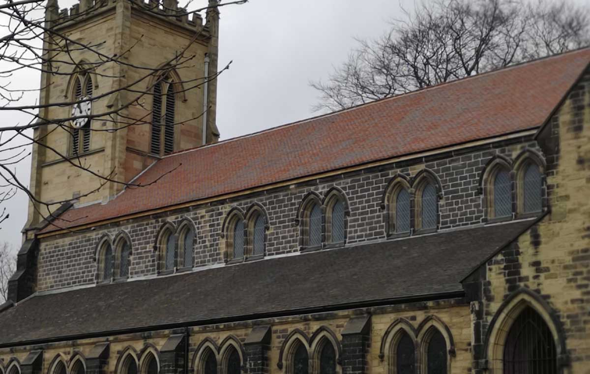 purple brown handmade clay roof tiles at St Margarets Church in Swinton