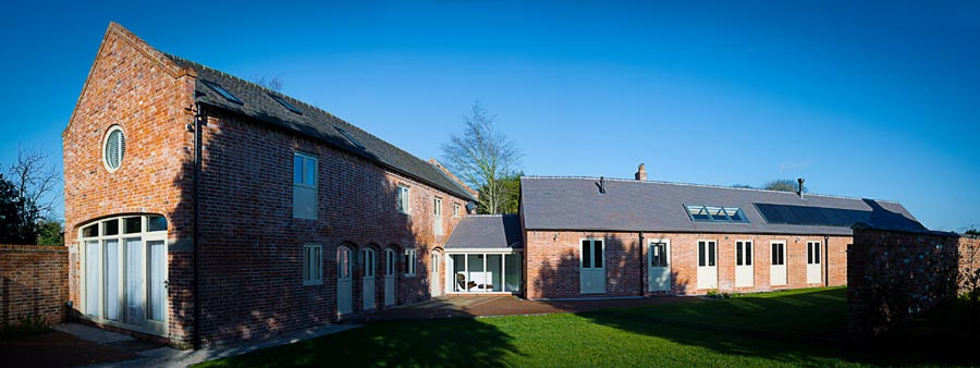 renovation from derelict farm building to a family home with staff blue sanded roof tiles to match old handmades